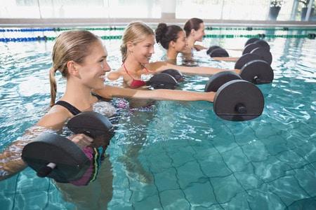 swimming pool workouts women exercising